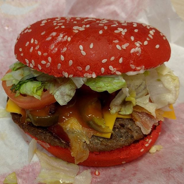 The Angriest Whopper…has hot sauce baked into the bun, which provides a surprising amount of heat. There's bacon, angry onions, jalapeños and a spicy sauce as well